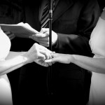Photo of two brides exchanging wedding rings with holga effect