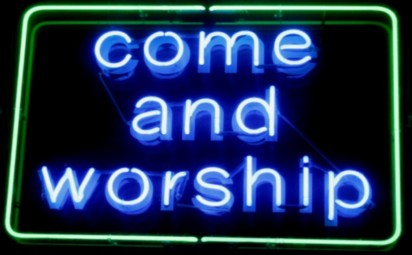 "A neon sign which reads ""Come and worship"""